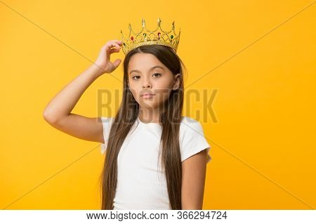 Compelling Baby. Kid Wear Golden Crown Symbol Of Princess. Girl Cute Baby Wear Crown While Stand Yel