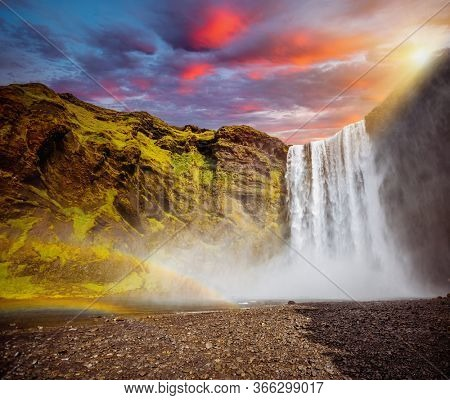 Impressive view of powerful stream of the famous Skogafoss waterfall. Location place Skoga river, Iceland, Europe. Photo of popular tourist attraction of the world. Discover the beauty of earth.