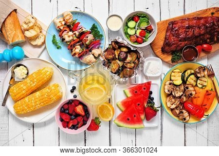 Summer Bbq Or Picnic Food Concept. Assortment Of Grilled Meats, Vegetables, Fruits, Salad And Potato