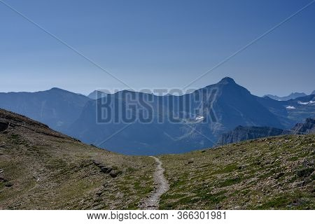 Trail Heads Down Over Mountain From Siyeh Pass In Montana Mountains