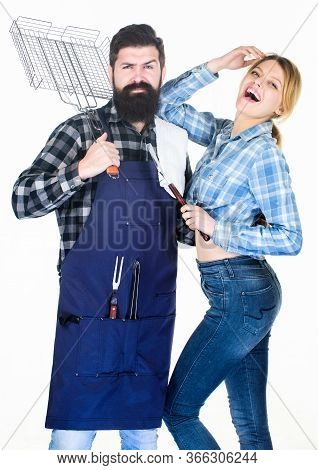 Essential Barbecue Dishes. Family Getting Ready For Barbecue. Bearded Hipster And Girl Hold Cooking
