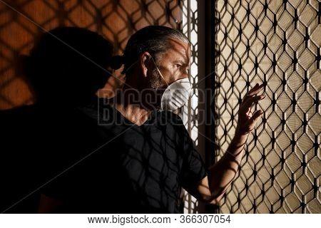 Coronavirus Male Medical Mask Quarantine, Self Isolation Concept, Frustrated Middle Aged Man Wearing