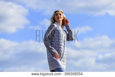Windy Day. Girl Jacket Cloudy Sky Background. Woman Fashion Model Outdoors. Woman Enjoying Cool Weat