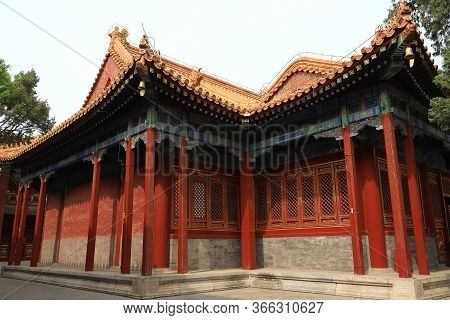 Chinese Style Building With Red Wall And Yellow Roof In Cining Garden