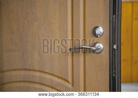 Modern Chrome Stainless Steel Door Knob On A Natural Hardwood Door With Black Wooden Door Frame. Con