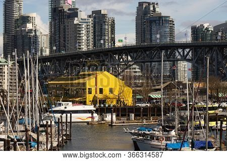 Vancouver, Canada - February 29,2020: View Of Granville Island And Granville Bridge With Vancouver C