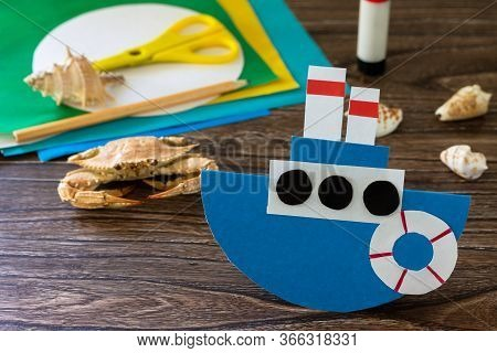 Gift Paper Boat For Father's Day On A Wooden Table. Children's Art Project, Craft For Children. Craf