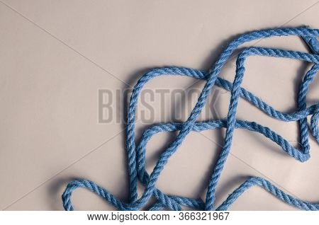 Thin Blue Rope On A Light Thunderstorm Background.
