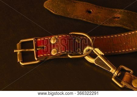 Old Red Leather Dog Collar With A Leash.