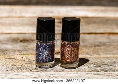 Colorful, Bright And Glittery Nail Polish Bottles Isolated With Copy Space. Close Up Of Bottles With