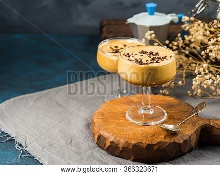 Frappe Frothed Cold Coffee Drink In Dessert Stemmed Glasses On Brown Wooden Board