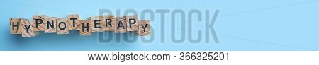 Wooden Blocks With Word Hypnotherapy On Light Blue Background, Flat Lay
