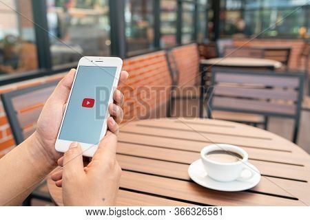 Chiang Mai, Thailand - Feb.15,2020: Man Holding Apple Iphone 8plus With Youtube Apps On Screen. Yout