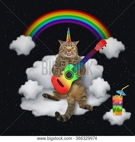 The Beige Cat Unicorn Is Playing The Acoustic Guitar And Singing A Song On A Cloud Sofa Under The Ra