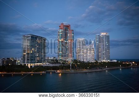 City Is Falling Asleep. Nightlife Concept. Cityscape After Sunset. Modern Skyscrapers. Visual Appear
