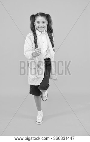 Schoolgirl Wear Raincoat. Schoolgirl Wear Water Resistant Clothes. Rainy Day. Cute Schoolgirl Feel P