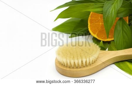 Anti-cellulite Massage Brush On A White Background. Orange Peel Cellulite Concept. Lymphatic Drainag