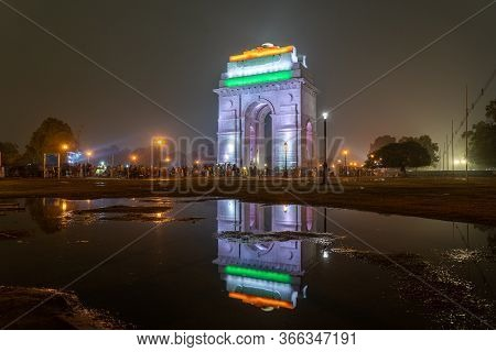 New Delhi, India - December 13, 2019: People In Front Of The Illuminated India Gate At Night