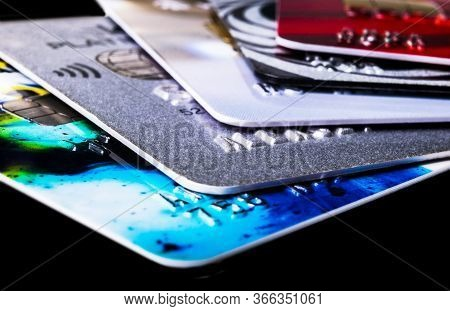Credit Card Isolated On Black Background. Macro Shot. Close Up Credit Card Payment. Macro Shot Of Ch
