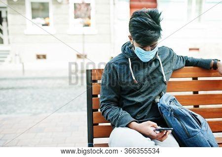 Coronavirus Covid-19 Concept. South Asian Indian Man Wearing Mask For Protect From Corona Virus Sitt