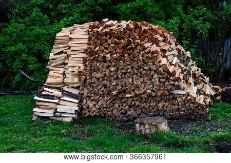The Wood Is Piled Up In A Big Pile. Preparation Of Firewood For The Winter. Dry Chopped Firewood Log