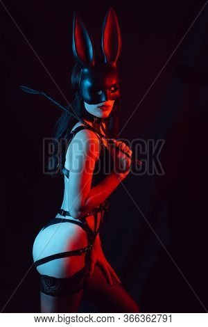 Sexy Dominatrix Mistress In Bunny Mask With Leather Whip For Bdsm