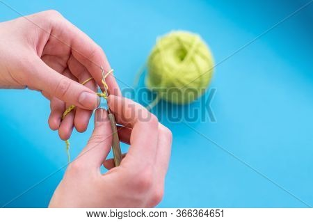 Crocheted Hands With Cotton And Crochet On A Light Background, Selective Focus, With Copy Space, Han