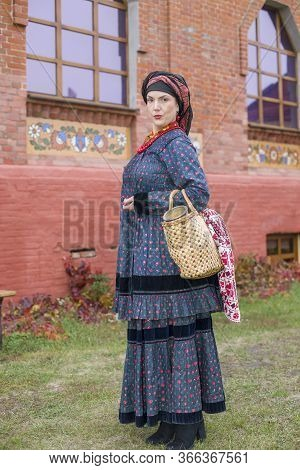 Woman With A Basket In Retro Clothes Of The 19th Century. Antique Clothing Of The Late 19th Century.