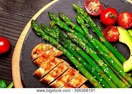 Baked Chicken Garnished With Asparagus And Herbs. Healthy Food, Ketogenic Diet, Diet Lunch Concept.