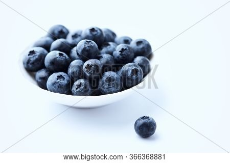 Bilberries Isolated On White Background. Concept For Healthy Nutrition. Copy Space.
