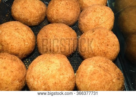 Arancini (deep Fried Rice Balls With Meat) Typical Sicilian Street Food At Market In Italy. Lots Of