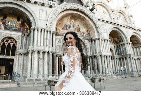 Bride In Motion,running Bride,beautiful Bride In A Wedding Dress Walks In The Old City,happy Bride A