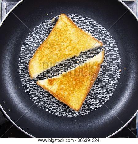 Chef Baking Parmesan Cheese Toast By Pan / Bake Parmesan Cheese Toast By Pan Concept