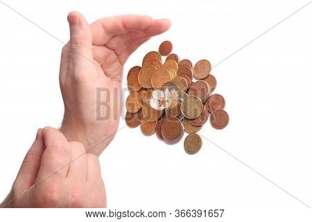 Green Sprout Sprouts From A Stack Of Coins On A White Background. Hand Takes Coins. Isolated. Invest