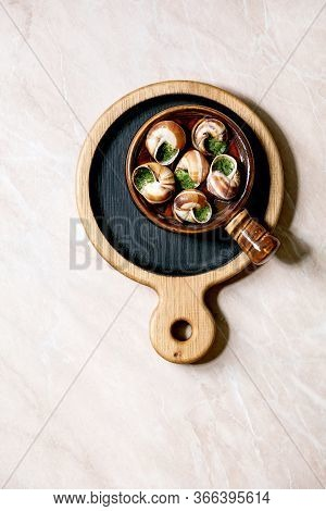 Escargots De Bourgogne - Snails With Herbs Butter, Gourmet Dish, In Traditional Ceramic Pan On Woode