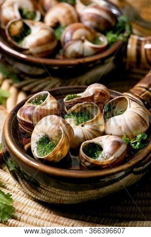 Escargots De Bourgogne - Snails With Herbs Butter, Gourmet Dish, In Two Traditional Ceramic Pans Wit