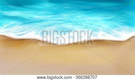Top View Of Sea Wave With Foam Splashing On Beach With Sand. Blue Ocean Foamy Water Splash On Coastl