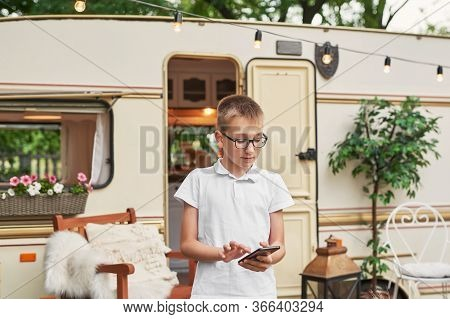 Child Boy Near House On Wheels. Family Vacation Travel Rv,holiday Trip In Motorhome.caravan Car Vaca