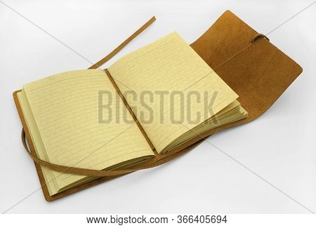 Open Brown Leather Bound Personal Journal On White Background.