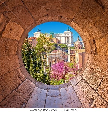 Rome. Scenic Springtime View Through Stone Window Over The Ruins Of The Roman Forum In Rome, Capital