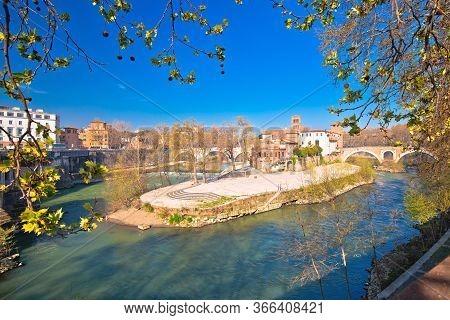 Rome. Tiber Island Or Isola Tiberina On River In Rome View, The Basilica Of St. Bartholomew, Capital