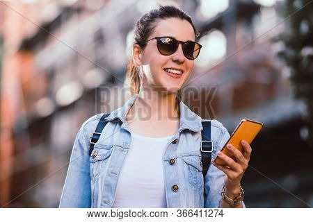 Woman With Cell Phone. Woman Portrait With Cell Phone On City Street. Woman Taking Selfie With Cell