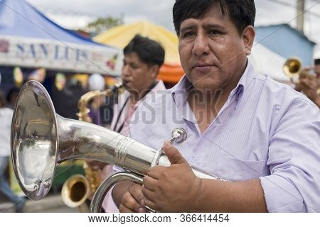 Sao Paulo, Brazil - December 13, 2015: Bolivian Immigrant From A Traditional Music Band Holding A Tr