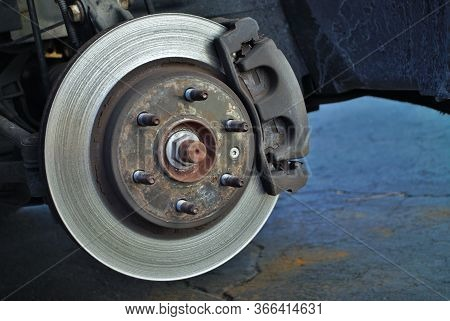 Ruined Disc Brake Rotor Seen On A Vehicle