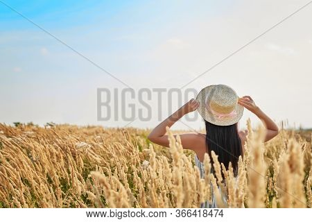 Summer Vacation. Holidays In Village. Outdoor Lifestyle. Freedom Concept. Woman In Summer Field. Gir