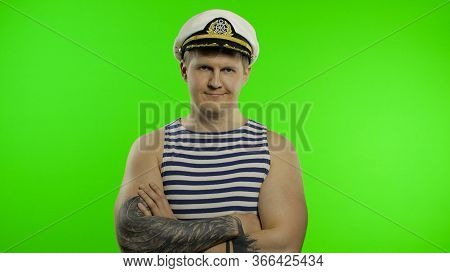 Young Muscular Sailor Man Arms Crossed Looking At Camera. Seaman Guy Smiling In Sailors Vest. Stripe