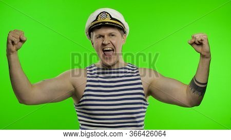 Young Sailor Man Celebrates Yelling Emotionally And Raises His Hands. Seaman Guy Smiling In Sailors