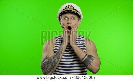 Young Muscular Sailor Man Expresses Shock, Looks Surprised. Seaman Guy Smiling In Sailors Vest. Stri