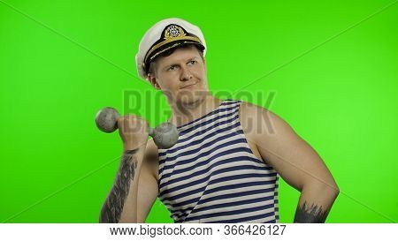 Young Muscular Sailor Man Making Weightlifting With Dumbbell. Seaman Guy Smiling In Sailors Vest. St