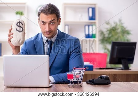 Young male businessman in ecommerce concept